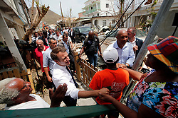 France's President Emmanuel Macron greets residents during his visit in the French Caribbean islands of St. Martin, Tuesday, Sept. 12, 2017. Macron is in the French-Dutch island of St. Martin, where 10 people were killed on the French side and four on the Dutch. Photo by Christophe Ena/Pool/ABACAPRESS.COM