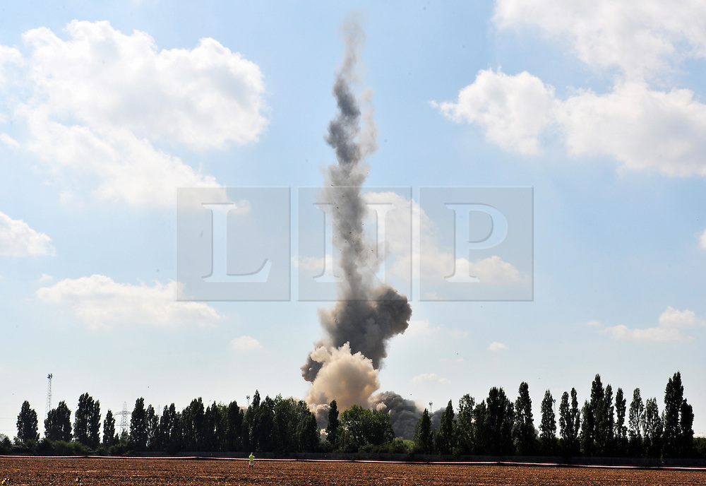 © Licensed to London News Pictures. 07/09/2016<br /> Frame 7<br /> Grain Power Station chimney demolition in Kent.<br /> <br /> One of the country's tallest structures has been demolished this morning at 11am.<br />  The Power Station chimney is 244m (801 ft) which makes it taller than Canary Wharf in London. <br /> <br />  The demolition is a British record for the tallest concrete structure to be blown up!<br /> <br /> <br /> <br /> (Byline:Grant Falvey/LNP)