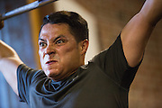 Juan Carlos Miranda performs a squat clean and press during a CrossFit program at ThirdSpace Fitness in San Jose, California, on July 6, 2015. (Stan Olszewski/SOSKIphoto for Content Magazine)