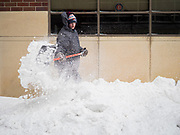 17 JANUARY 2020 - DES MOINES, IOWA: Wind blows snow around a worker shoveling a snow packed sidewalk in the Court District of Des Moines. The second significant snow fall in a week hit central Iowa Friday. The snow started falling during the morning rush hour and by early afternoon about five inches had fallen in Des Moines. Meteorologists said up to 1/10 of an inch of ice could cover the snow by the end of the day. The snowstorm was expected to turn into a blizzard in northern Iowa on Saturday with wind speeds above 30MPH. Many businesses in the Des Moines area closed early Friday and several of the Democratic presidential candidates cancelled their campaign events because of the snow.      PHOTO BY JACK KURTZ