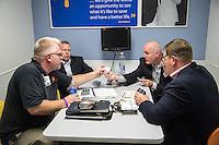 BENTONVILLE, AR - JULY 7:  Scott Bonge of Goatee Saver makes his presentation to Kyle Kuykendall (Financial Planner), Jason Kloster (Senior Buyer) and Shaun Townzen (VP Personal Care) of Walmart at the Walmart Head Quarters in Bentonville, Arkansas.<br /> Wesley Hitt for the Wall Street Journal