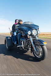 Pat Schock (Army Reserves) of the Old Cronies in Aberdeen, SD and his wife Angie on their Harley-Davidson Tri Glide in the USS South Dakota submarine flag relay near Groton as it crosses South Dakota. USA. Sunday October 8, 2017. Photography ©2017 Michael Lichter.