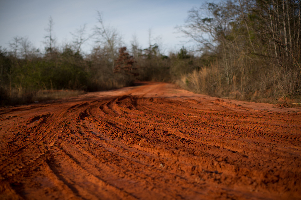 Georgia red clay at the entrance of a dirt road just outside of Lumpkin, Ga., on Thursday, Jan. 14, 2016. Much of Stewart County (Lumpkin is county seat) is rural. Shot for a story about Shawn Toussaint, who is in federal custody at the Stewart Detention Center, where immigrants are detained, in Lumpkin and was denied release during a hearing Thursday. Photo by Kevin D. Liles for NPR