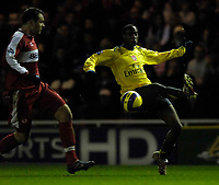 Photo: Jed Wee.<br /> Middlesborough v Arsenal. The Barclays Premiership. 03/02/2007.<br /> <br /> Arsenal's Justin Hoyte (R) controls the ball as Middlesbrough's Mark Viduka looks on.