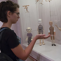 Visitor plays with puppets on display at an interactive puppet exhibition in the Petofi Literature Museum in Budapest, Hungary on Sept. 6, 2018. ATTILA VOLGYI