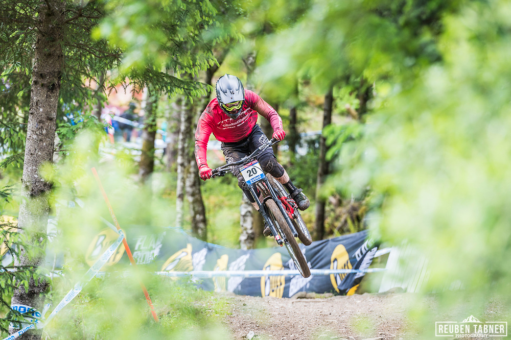 Charlie Hatton takes flight during his race run at the UCI Mountain Bike World Cup in Fort William.