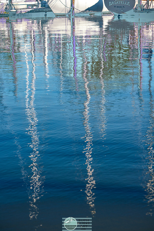 Abstract reflections in water inspired by coastal elements