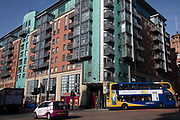 Apartments and traffic in Manchester, England, United Kingdom. Much of the centre of the city is being redeveloped creating a prosperous place to live. Manchester is a major city in the northwest of England with an industrial heritage.