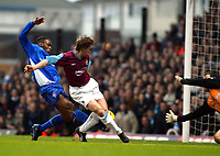 Photo. Chris Ratcliffe<br /> West Ham United v Ipswich Town. Nationwide 1st Division 26/12/2003<br /> David Connolly cannot convert this chance as Fabian Wilnis of ipswich closes in.