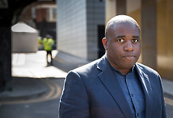 © Licensed to London News Pictures. 05/04/2018. London, UK. David Lammy MP talks to reporters near where a police tent covers the murder scene in Hackney after a 18 year old man, named locally as Israel Ogunsola, was stabbed in Link Street. Police were approached by a man suffering from stab injuries at 8pm last night he was pronounced dead at 8. 24pm by officers. Photo credit: Peter Macdiarmid/LNP