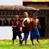 Monks playing football in Bhutan