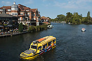 An amphibious vehicle owned by Windsor Duck Tours approaches Eton Bridge on the river Thames on 19 September 2020 in Windsor, United Kingdom. Windsor Duck Tours offers sightseeing itineraries around Windsor on road and river.