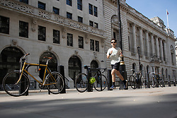 © Licensed to London News Pictures. 15/06/2021. London, UK. A man jogs during sunny weather in Westminster, Central London. Temperatures are expected to rise with highs of 25 degrees forecasted for parts of London and South East England today . Photo credit: George Cracknell Wright/LNP