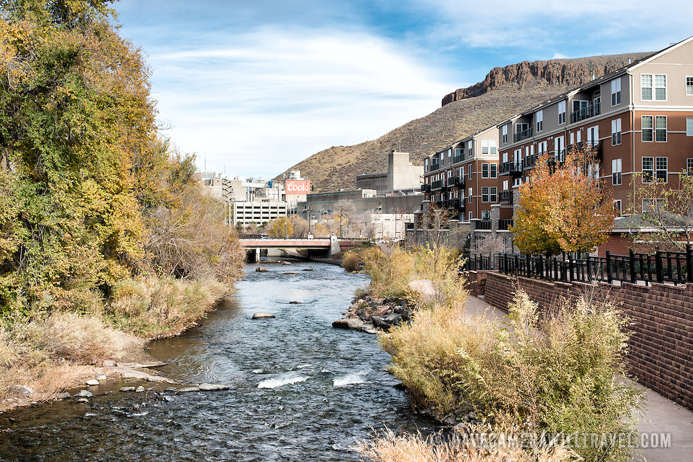Clear Creek in Golden, Colorado, runs to the Coors Brewery which can be seen in the distance, with part of Table Mountain visible in the background at right.