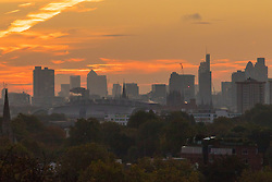 Primrose Hill, London, October 28th 2016. Skyscrapers are thrown into silhouette against the brightening sky as dawn breaks over London.