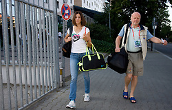 Athlete Marija Sestak  of Slovenia and helping with Marjan Hudej at departure back to Slovenia during day five of the 12th IAAF World Athletics Championships at the Hotel Estrel on August 18, 2009 in Berlin, Germany. (Photo by Vid Ponikvar / Sportida)
