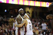 Ben Wallace, left, and Delonte West of Cleveland during a game against visiting Memphis.