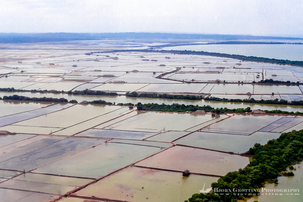 Java, East Java, Madura. The large fields for extraction of salt from sea water cover large areas of southern Madura (from helicopter).
