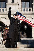 A man makes a Nazi salute at counter-protesters during the 2016 fall political rally of the National Socialist Movement at the Pennsylvania State Capitol.