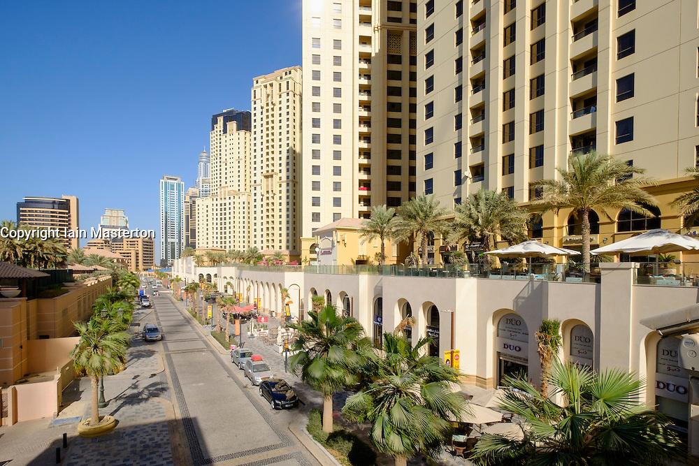 View along The Walk shopping and eating street at Jumeirah Beach Residences (JBR) in marina district of Dubai United Arab Emirates