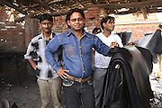 The owner of a small tannery in Jajmau Industrial Area, Kanpur, Uttar Pradesh, is showing the leather just painted in their unit. Arrived from somewhere else, painted by the two children I have witnessed working here, it will depart to reach other hands, and later become an item for sale. In Jajmau this is a daily reality and an intervention is needed to curb the practice.