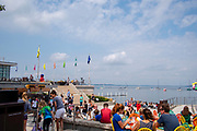 People enjoy lunch, snacks and beer on the Terrace at the Memorial Union, University of Wisconsin, Madison, Wisconsin on a beautiful summer day.