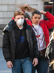 © Licensed to London News Pictures. 02/03/2020. London, UK. Passenger at Victoria Station in protective mask as fears of a pandemic increase after 4 new cases of Coronavirus are confirmed in the UK. Photo credit: Alex Lentati/LNP