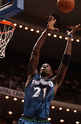 March 27, 2003, Orlando, Florida, USA;  Kevin Garnett of the Minnesota Timberwolves goes up for a lob pass to the basket as he dunks for two of his 26 points against the Orlando Magic.  The Magic defeated the Timberwolves 110-107.