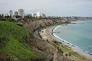 A beach of the South Pacific Ocean lies under cliffs of Miraflores District, an upscale neighborhood in Lima, Peru, South America.