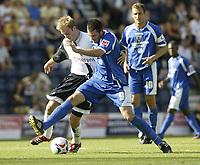 Photo: Aidan Ellis.<br /> Preston North End v Cardiff City. Coca Cola Championship. 09/09/2006.<br /> Cardiff's Steve Thompson battles with Preston's Chris Sedgwick