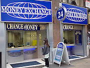 Money Exchange change money shop signs, London, England