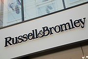 Sign for the brand and shoe shop Russell and Bromley in Birmingham, United Kingdom.