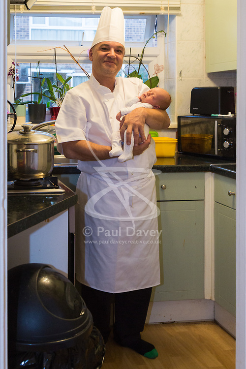 Costas Mina delivered his partner Natalie's baby Harry at home whilst waiting for an ambulance, using an apron string to tie off the umbilical cord. Harry is a new sibling forCostas and Natalie's daughter Amber, who is nearly two. London, August 23 2018.