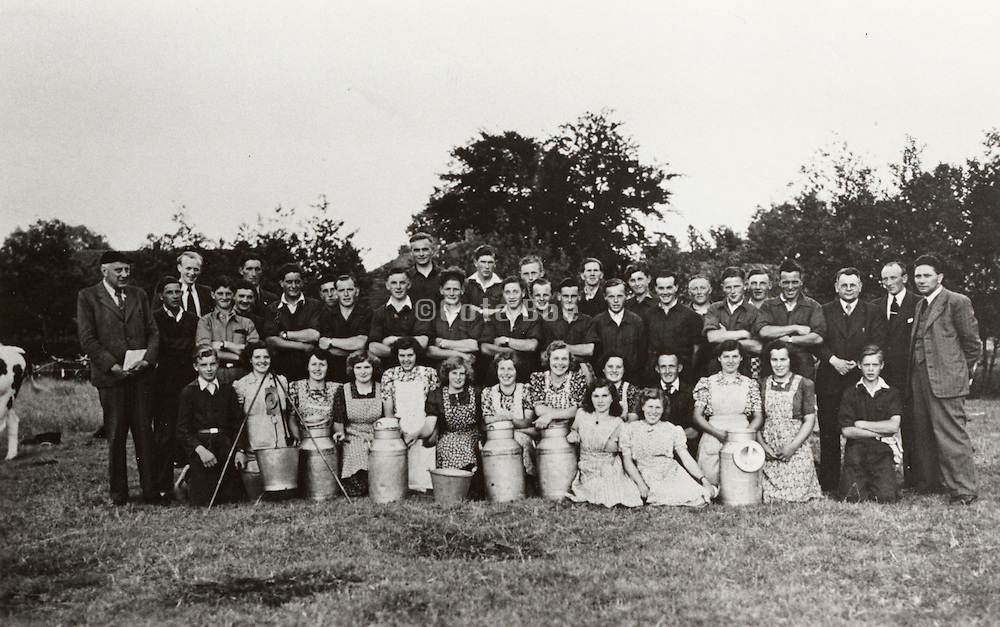 Group photograph of young farmers and their wives in a farmers community.