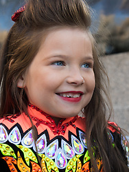 London, March 13th 2016. The annual St Patrick's Day Festival takes place in Trafalgar Square with performances on stage and plenty of Irish food and drink for the thousands of revellers.  PICTURED: A girl from an Irish dancing troupe waits to go on stage. ©Paul Davey<br /> FOR LICENCING CONTACT: Paul Davey +44 (0) 7966 016 296 paul@pauldaveycreative.co.uk