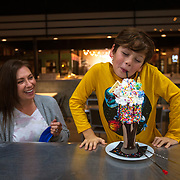 Coda Giannini, right, enjoys a milkshake as his mother Michelle watches at Gracie's Milkshake Bar in the L & L Market in Nashville, Tennessee. Nathan Lambrecht/Journal Communications