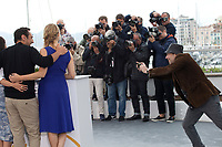 Actor, Mathieu Amalric photographs Virginie Efira and Gilles Lellouche at the Le Grand Bain (Sink Or Swim) film photo call at the 71st Cannes Film Festival, Sunday 13th May 2018, Cannes, France. Photo credit: Doreen Kennedy