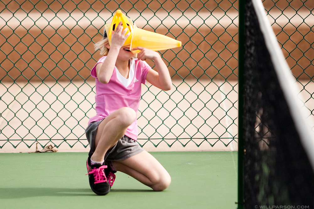Stella Chopskie, 5, plays with some cones during practice.