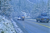 Traffic on the Beartooth Scenic Byway during a July snow storm.  Beartooth Mountains, Wyoming.