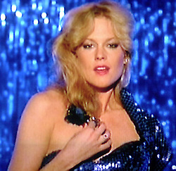 In one of her early films, actress Melanie Griffith dances to a beat in a 'glamour' picture.