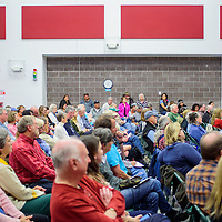 A crowd of bidders packs the gymnasium during the Crownpoint Rug Auction at Crownpoint Elementary School April 8.