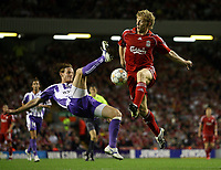 Photo: Paul Thomas.<br /> Liverpool v Toulouse. UEFA Champions League Qualifying. 28/08/2007.<br /> <br /> Dirk Kuyt of Liverpool in action against Mauro Cetto (L).