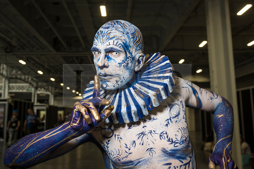 © Licensed to London News Pictures. 18/05/2019. LONDON, UK. A model poses in a completed work at the International Make-Up Artists Trade Show (IMATS) taking place at Kensington Olympia 16 to 19 May 2019.  The show brings together make-up artists from around the world, including those with Hollywood movie backgrounds, providing classes in theatre, film, TV, fashion and editorial make-up to professionals and enthusiasts.  Photo credit: Stephen Chung/LNP