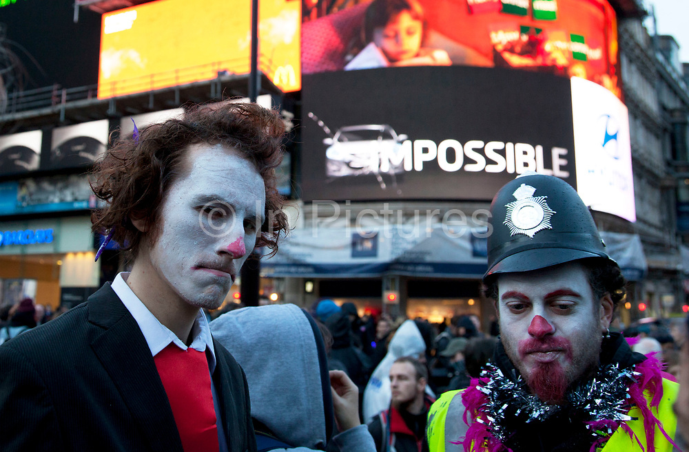 Anti-capitalist protesters dressed as banker clowns split off from the main N30 protest and demonstrated at Piccadiully Circus. Mocking police and bankers, they were the entertainment in a situation where the police 'contained' or kettled protesters.