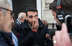 © Licensed to London News Pictures. 14/09/2017. London, UK. Grenfell resident Sid-Ali Atmani wipes away a tear as he talks to reporters outside The Connaught Rooms on the first day of the public inquiry into the Grenfell fire. Police say they believe 80 people died in the tragedy. Photo credit: Peter Macdiarmid/LNP