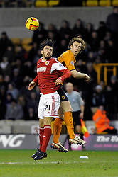 Wolverhampton Wanderers' Kevin McDonald challenges for the ball with  Bristol City's Marlon Pack in the air - Photo mandatory by-line: Dougie Allward/JMP - Tel: Mobile: 07966 386802 25/01/2014 - SPORT - FOOTBALL - Molineux Stadium - Wolverhampton - Wolverhampton Wanderers v Bristol City - Sky Bet League One