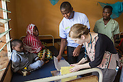 Dr Godfrey Kambanga and Dr Siobhan Neville look through patient notes on the children's ward during the daily rounds.  The rounds are attended by all the medical staff who work on that ward, doctors, nurses and attendants. St Walburg's Hospital, Nyangao. Lindi Region, Tanzania.