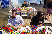 Anthony Petronelli (center) works with a Zoob display during the Silicon Valley Business Journal's HHaaS Tech Mixer at ZERO1 in San Jose, California, on May 28, 2015. (Stan Olszewski/SOSKIphoto for the Silicon Valley Business Journal)