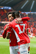 Charlton Athletic midfielder Joe Aribo (17) celebrates with Charlton Athletic forward Nicky Ajose (25) after scoring a goal taking his team to a 2-1 lead during the EFL Sky Bet League 1 match between Charlton Athletic and Bristol Rovers at The Valley, London, England on 24 November 2018.