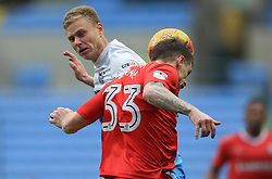 18 February 2017 - Skybet League One - Coventry City v Gillingham - Mark Byrne of Gillingham just heads away from Andy Rose of Coventry City - Photo: Paul Roberts / Offside
